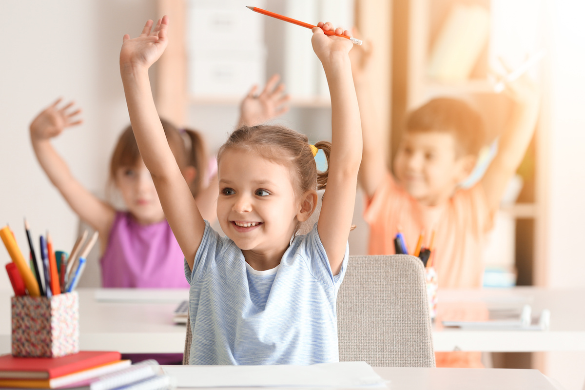 Cute girl at lesson in classroom - Quillette